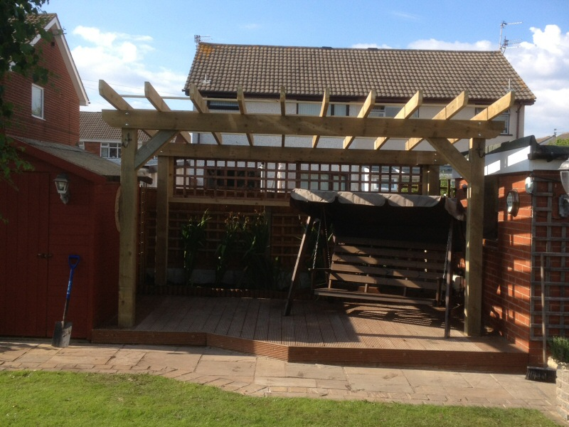 Photo - Decking / Pergola (1 of 1) - Decking with a feature pergola installed to the rear garden of a Fleetwood property. - Decking - Home - © J C Joinery