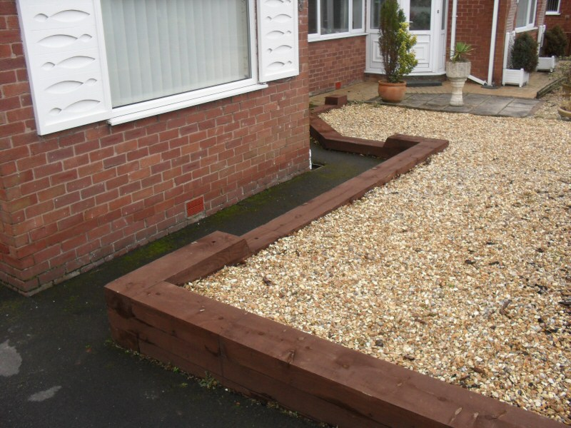 Photo - Raised Beds (1 of 1) - Raised beds with railway sleepers and golden gravel inset for garden in Preston. - Other Joinery and Building Work - Home - © J C Joinery